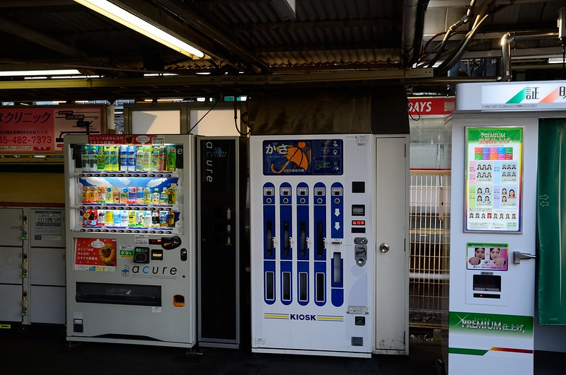 An Umbrella Vending Machine wedged between two other vending machines