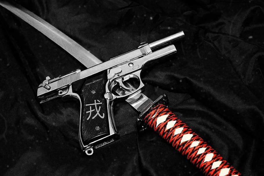 A handgun and a katana.