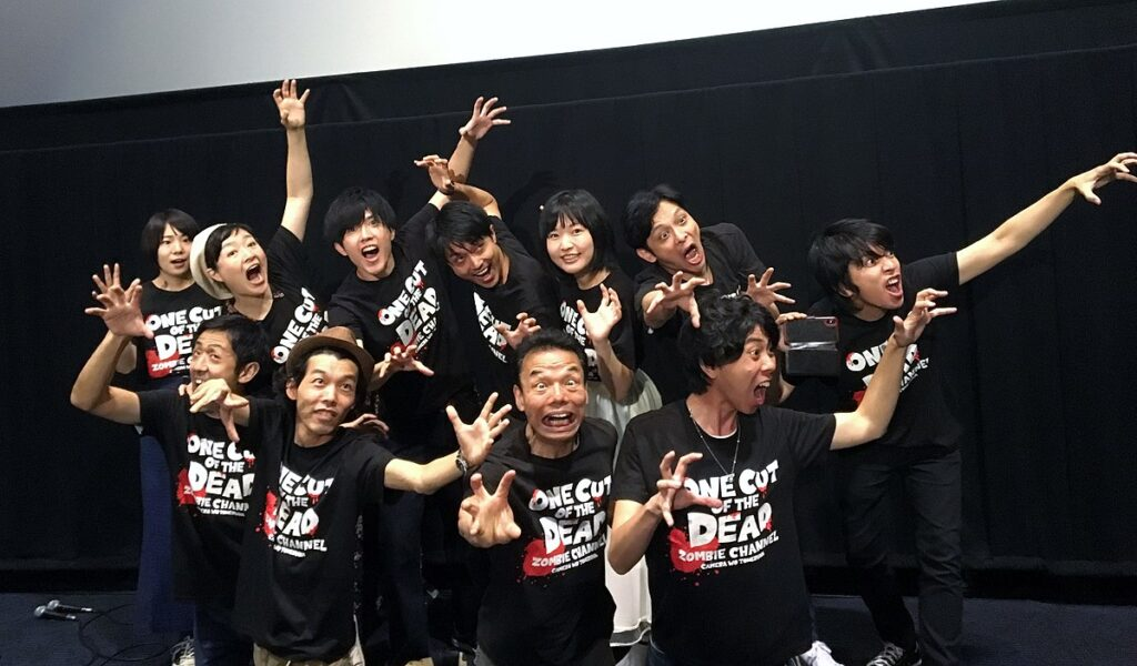The Cast of One Cut of the Dead with the Director. Photo from Wikimedia Commons.