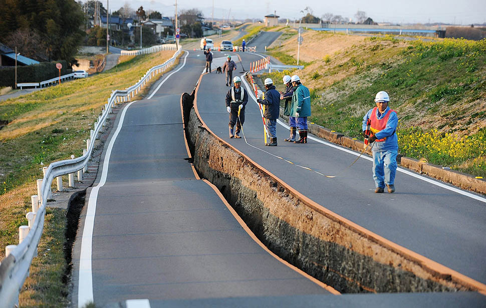 Workers checking a road after the 2011 earthquake