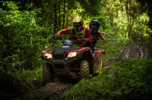 Man and woman Riding and ATV